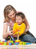 stock photo of babysitter  - Mother and son playing on the floor with toys - JPG