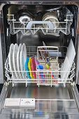 Packed Dishwasher Of Clean Dishes