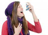 Woman With Asthma Using An Asthma Inhaler
