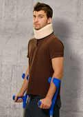 picture of neck brace  - Disabled Man With Neck Brace Holding Euro Note - JPG