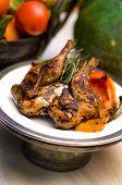 Rotisserie Chicken With Rosemary Garnish