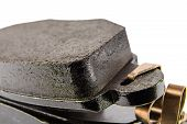foto of friction  - New brake pads into the brake system for a modern passenger car - JPG