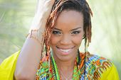 image of dread head  - Stock image of a young woman with her hand on her head - JPG