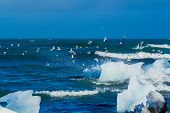 An Iceberg Being Broken By The Waves