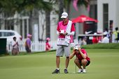 KUALA LUMPUR - OCTOBER 12: Beatriz Recari of Spain lines up for her putt on the 2nd hole green of the KLGCC course on Day 3 of the Sime Darby LPGA on October 12, 2013 in Kuala Lumpur, Malaysia.
