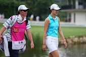 KUALA LUMPUR - OCTOBER 12: Michele Wie of USA walks with her caddy to the Hole 3 fairway of KLGCC co