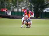 KUALA LUMPUR - OCTOBER 12: Chella Choi of South Korea lines up for her putt on the 2nd hole green of the KLGCC course on Day 3 of the Sime Darby LPGA on October 12, 2013 in Kuala Lumpur, Malaysia.