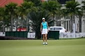 KUALA LUMPUR - OCTOBER 12: Michele Wie of USA watches her putts at the 2nd hole green of the KLGCC course on Day 3 of the Sime Darby LPGA on October 12, 2013 in Kuala Lumpur, Malaysia.