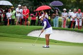 KUALA LUMPUR - OCTOBER 12: Lizette Salas of USA putts at the 2nd hole green of the KLGCC course on D