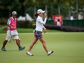 KUALA LUMPUR - OCTOBER 12: So Yeon Ryu of South Korea reacts after getting putt at the 2nd hole green of the KLGCC course on Day 3 of the Sime Darby LPGA on October 12, 2013 in Kuala Lumpur, Malaysia.