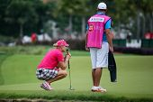 KUALA LUMPUR - OCTOBER 12: Anna Nordqvist of Sweden lines up for her putt on the 2nd hole green of the KLGCC course on Day 3 of the Sime Darby LPGA on October 12, 2013 in Kuala Lumpur, Malaysia.