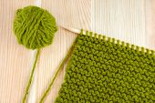 Green Wool And Garter Stitch On Knitting Needle