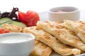Traditional Turkish flat bread called gozleme isolated on white background