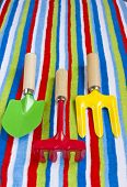 Stripy Beach Towel And Colorful Toys.
