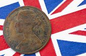 Queen Victoria One Penny Coin From 1864 On British Flag Background
