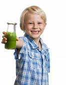 Happy Boy Holding Bottle Of Green Smoothie
