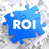 ROI on Blue Puzzle Pieces. Business Concept.