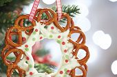 stock photo of pretzels  - Christmas Decoration with chocolate covered pretzels wreath - JPG