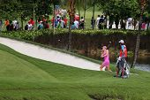 KUALA LUMPUR - OCTOBER 13: Michele Wie of USA chips the ball out of the sand bunker of the 9th hole