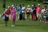 KUALA LUMPUR - OCTOBER 13: Michele Wie of USA discusses with her caddy on the next play at the KLGCC course on the final day of the Sime Darby LPGA on October 13, 2013 in Kuala Lumpur, Malaysia.