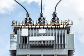 image of transformer  - Electric transformer against Blue Sky - JPG