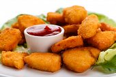 Chicken nuggets and vegetables on white background