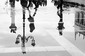 Venice reflects in puddle, Saint Marco square, Italy