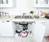 stock photo of clog  - Kitchen sink pipes and drain - JPG