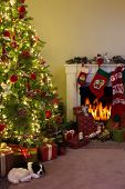Burning fireplace and a dog sleeping under the christmas tree