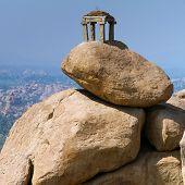 Old temple between stones in Hampi, Karnataka, India