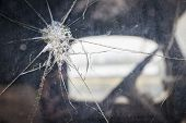 Abstract Cracked Window Glass on Antique Truck with Selective Focus.