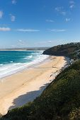 stock photo of st ives  - Carbis Bay Cornwall England near St Ives and on the South West Coast Path with a sandy beach and blue sky on a beautiful blue sky sunny day - JPG