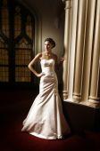 Bride Standing In Dark Room