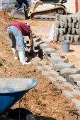 Construction Worker Laying Blocks