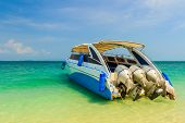 Speedboat On Beautiful Island Beach.