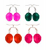 Earrings Made Of Glass On A White Background. Imitation Pearl
