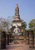 Buddha Statue Sitting Among The Ruins Of  Sukhothai