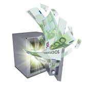 Euro banknotes are emitted from an open safe