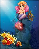 picture of underworld  - Illustration of a smiling mermaid sitting above the rocks - JPG
