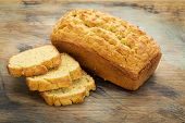 slices and loaf of freshly baked, gluten free bread made with almond and coconut flour and flaxseed