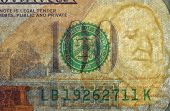 Watermark on redesigned new hundred dollar bill. One of paper securities.