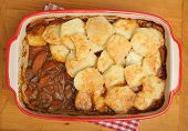 Beef stew with potato gratin topping.