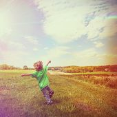 Boy running in a grassy field