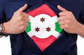 foto of burundi  - Young sport fan opening his shirt and showing the flag his country Burundi Burundian flag - JPG