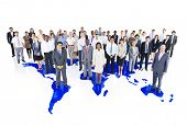 Group of Multi-Ethnic Business Colleagues Standing on a World Map Background