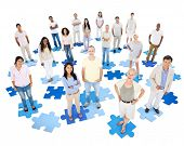 Large Group of World People Standing on Jigsaw Puzzle