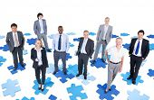 Group of Diverse Business People Standing on Jigsaw Puzzle