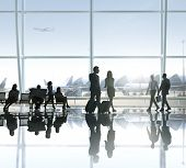 People Walking and Waiting in an Airport