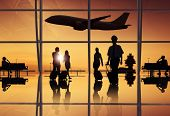 Silhouette of Travellers and Pilot at an Airport