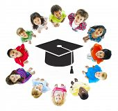 Education: Diverse Children Standing Around Mortarboard